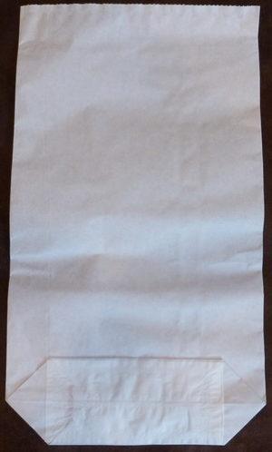 bílé papírové pytle